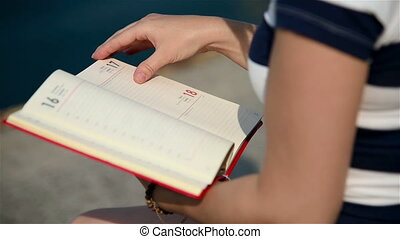 Girl Holding Blank Diary - Girl Turns The Pages In A Blank...