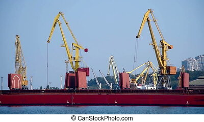 Tower Cranes In The Port Loads The Sand In Hold