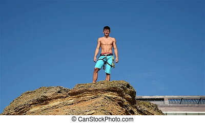 Climber Raising Hands On The Top - Extreme Climber Raising...