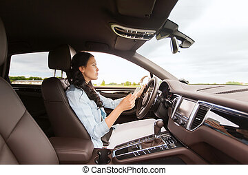 happy woman driving car with smarhphone - leisure, road...