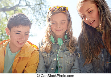 three happy teenage friends headphones - technology,...
