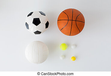 close up of different sports balls set over white - sport,...