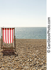 Deckchair - Portrait color photo of one striped red and...