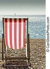 Deckchair - Portrait color photo of a single striped...