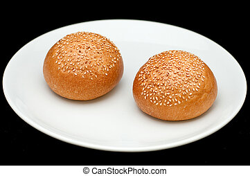 Two sandwich buns with sesame