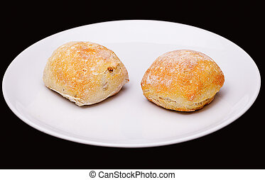 Two sandwich buns on white plate