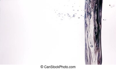Drops fall down on the vertical water surface in slow motion