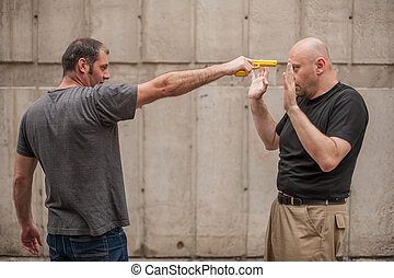Self defense techniques against a gun - Kapap instructor...