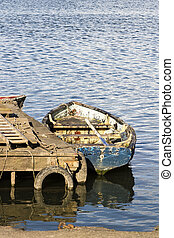 Rowing boat mored at the dock - Colour photo of an empty...