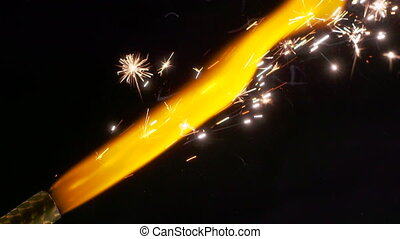Closeup lighted celebration firework sparkling candle for cakes slow motion