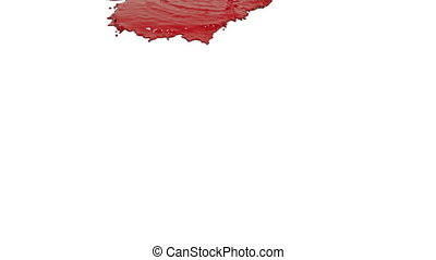 red liquid pouring on white background - close-up view of...