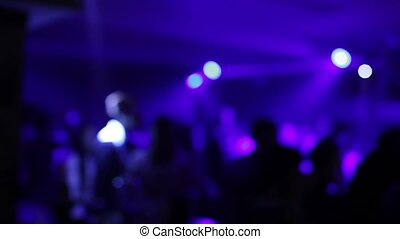 People dance at party in night club, bokeh