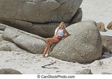 Sexy beach Babe - A gorgeous blonde in a swimsuit that...