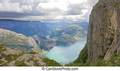Tourists hiking at the Preikestolen cliff in lysefjorden...