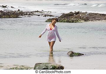Feeling Refreshed - Happy female in shirt and bikini...