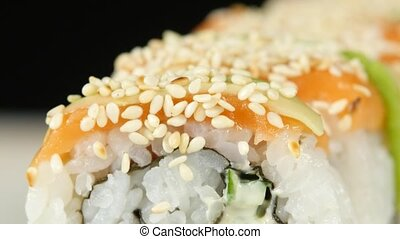 Master has prepared the rolls in sesame seeds. Close up -...