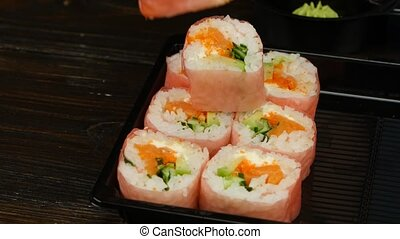 Layout of rolls to send to the consumer. Close up - People...