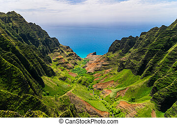 Aerial landscape view of cliffs and green valley, Kauai,...