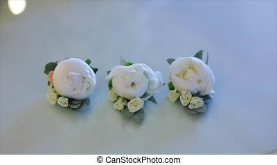 Beautiful boutonniere made from the white rose.