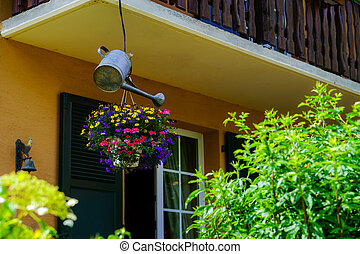 House decoration by flowers and watering pot, France