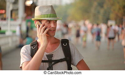man using a mobile phone on the street a handsome man in a...