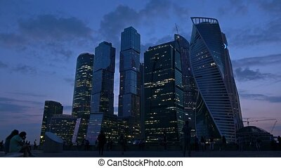 Moscow city business district skyscrapers and tourists at...