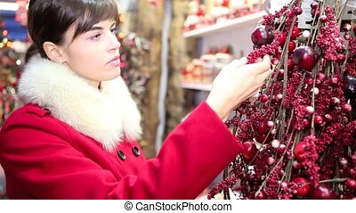 woman shopping christmas decorations in market store