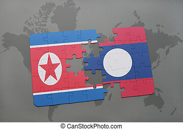 puzzle with the national flag of north korea and laos on a...