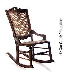 Antique Rocker - An antique cane rocking chair isolated on...