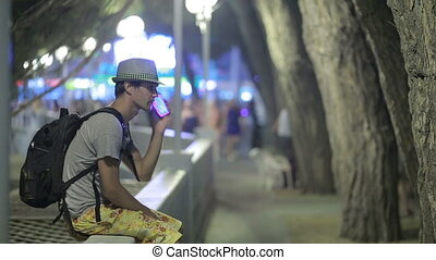 man using a mobile phone on the street. a handsome man in a...