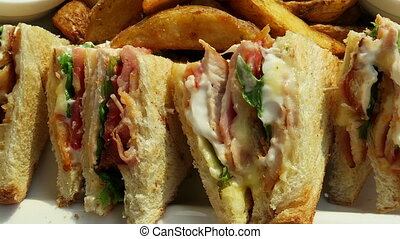 Club sandwich with chicken meat, country fries on a plate...