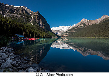 Lake Louise Boat House with mountain reflection
