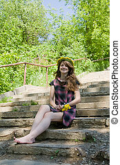 girl on the steps of stair - long-haired teen girl on the...