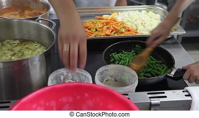 Close-up of chefs prepare food on a