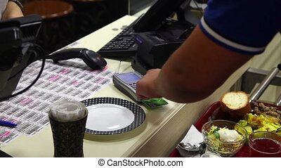 Credit card transaction - Closeup of a males hand enters a...