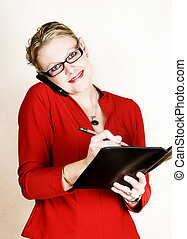 Multi tasking - Business woman in red suit speaking on phone...