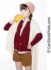 pretty girl drinking juice - cute girl holding a bottle of...