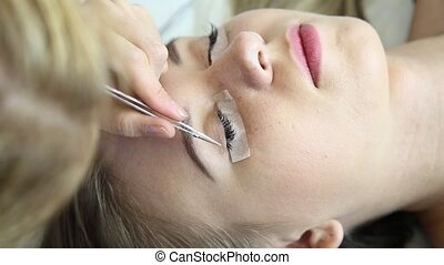 Beautiful young woman with eyelash extension Woman eye with...