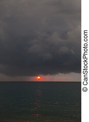 Stormy weather coastline during a sunset