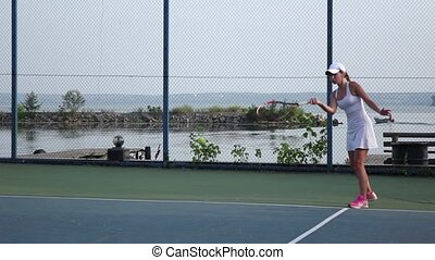 Women playing tennis. Outdoor courts - Female tennis player...