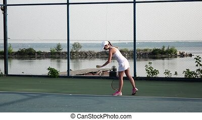 Female tennis player in action. Slow motion - Female tennis...
