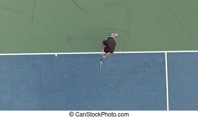 Serve with professional tennis player. Aerial shot. Slow...