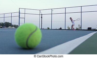 Tennis court with tennis balls and player. Slow motion -...