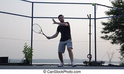 Tennis lesson. Slow motion - Man and girl playing tennis,...