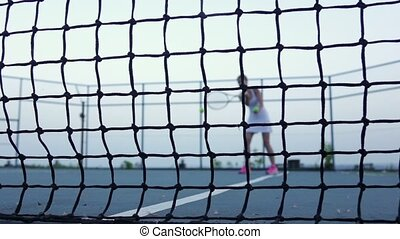 Tennis. Tennis the ball flying at the camera. Slow motion -...