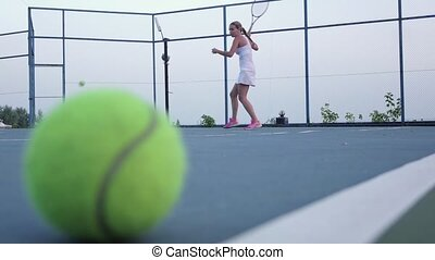 Tennis ball Slow motion - Tennis ball on the court, people...
