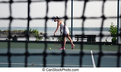 Tennis player in action Cam moves up Slow motion - Female...