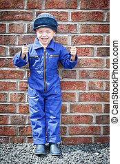 Little Mechanic - Small boy dressed with blue workwear...