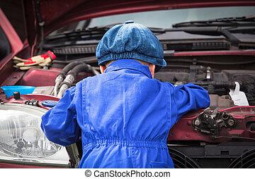 Little Mechanic Boy - Little boy in blue workwear overall in...