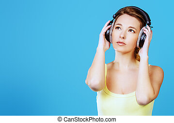 nice melody - Modern girl enjoys listening to music in...